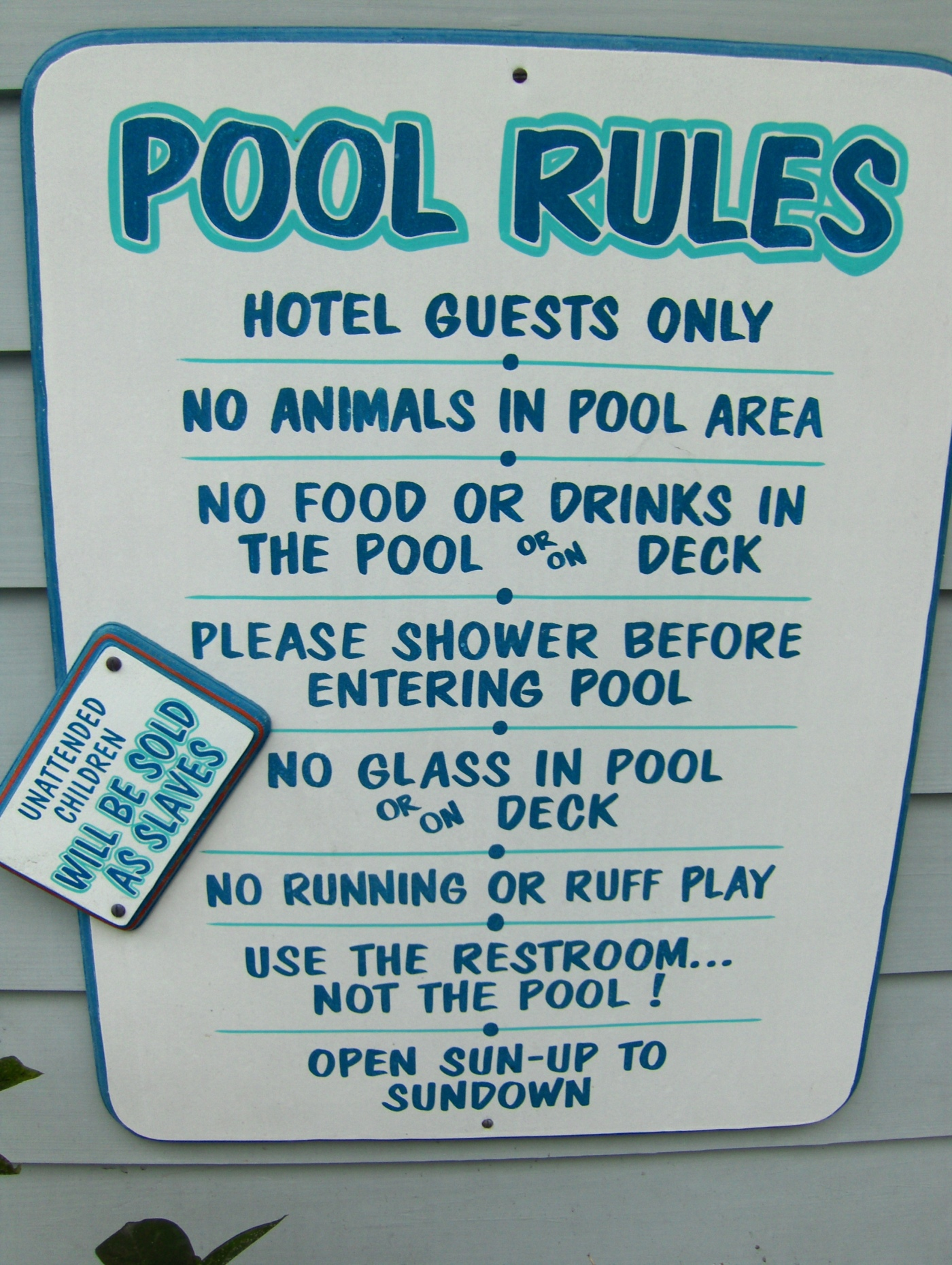Image of a sign listing pool rules