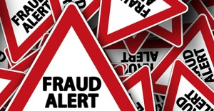 Red signs reading 'Fraud alert'